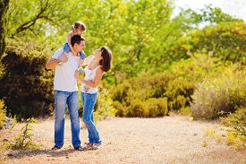 stock photo of grass area  - The young family - JPG