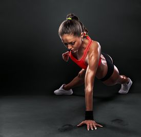 stock photo of fitness  - Young Woman Doing Push - JPG