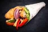 image of sandwich wrap  - Wrap sandwich stuffed with fried chicken meat and vegetablesselective focus - JPG