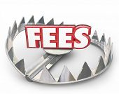 Постер, плакат: Fees word in red 3d letters on a steel bear trap with pointy teeth to illustrate or warn you of late