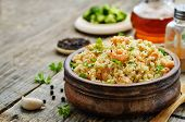 foto of quinoa  - quinoa with shrimp and parsley on a dark wood background - JPG