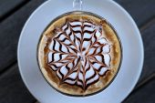 pic of latte  - Hot latte coffee in glass on wood table - JPG