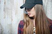 picture of sad eyes  - Waist up portrait of beautiful hipster girl with cap on her head - JPG