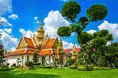 picture of buddhist  - Great Palace Buddhist temple with famous green tree gardens in center of Bangkok - JPG