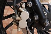 foto of motorcycle  - Disc brake of eco motorcycle scooter motorcycle background - JPG