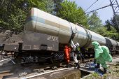 pic of decontamination  - A team working with toxic acids and chemicals is securing a chemical cargo train tanks crashed near Sofia Bulgaria - JPG