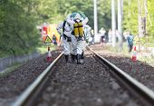 foto of decontamination  - A team working with toxic acids and chemicals is approaching a chemical cargo train crash near Sofia Bulgaria - JPG