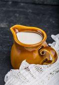 stock photo of jug  - jug with milk on a black background - JPG