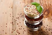stock photo of quinoa  - Stack of bawls with red - JPG