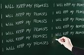 pic of punishment  - I will keep my promises sentence written repeatedly on blackboard as a punishment - JPG