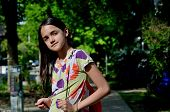 foto of little school girl  - Little Hispanic girl walks to school on a sunny day - JPG