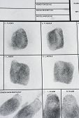 foto of fingerprint  - Fingerprint on police fingerprint card and black background - JPG