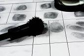 stock photo of fingerprint  - Fingerprint on police fingerprint card and black background - JPG