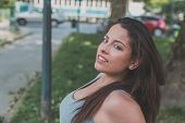 picture of curvy  - Portrait of a beautiful young curvy girl in tank top posing in an urban context - JPG