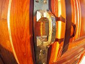 stock photo of door  - Old bronze door handle close - JPG
