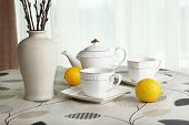 picture of teapot  - Willow twigs in vase with teapot - JPG