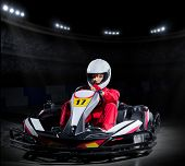 picture of armored car  - Young girl karting driver at sports hall - JPG
