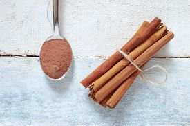 stock photo of substitutes  - Some cinnamon sticks tied with a natural rope - JPG