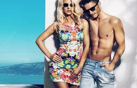 stock photo of couple  - Happy fashionable couple on sunny vacation day - JPG