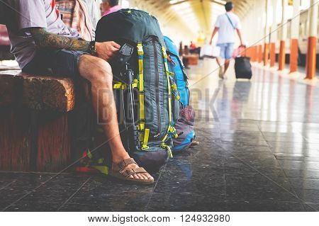 poster of Portrait of a young man traveler waiting for train and travel bag.
