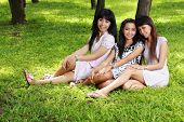 asian girl best friends together smiling