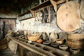 Ancient interior. Beautiful antiquarian tableware in old kitchen.