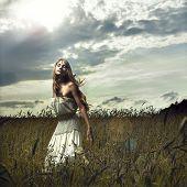Photo of romantic woman in wheat field