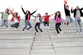 group students jumping end of exam year