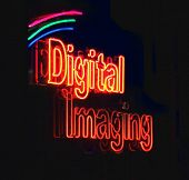 View of a glowing Digital Imaging neon sign.
