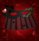 pic of mummer  - against the red background of the carnival black half mask decorated feathers and veil - JPG