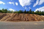 Storage Of Wooden Bio Fuel Against Blue Sky