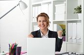 Portrait Of Happy Businesswoman Celebrating Something With Arms Up poster