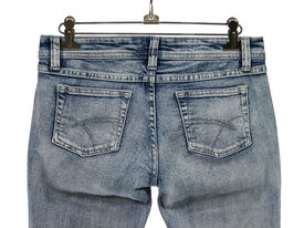 stock photo of denim jeans  - closeup of blue jeans with pockets rear view - JPG