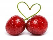 two cherries with drops tied into a heart love