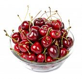 Cherry on glass bowl isolated on the white background