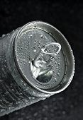 drink can with water droplets on black background