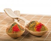 spice powder mix in a wooden spoon on a bamboo napkin