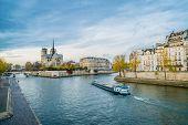 Notre-dame-de-paris, The Seine River And A Boat In Paris In Autumn poster