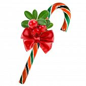 christmas cane with red berries isolated on white