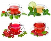 Cup of tea with fresh berries, fruit ,herbs isolated on white