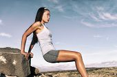 Strength training fitness woman working out arms muscles doing triceps dips. Asian athlete exercisin poster