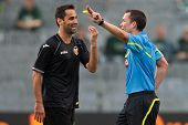 VIENNA,  AUSTRIA - JULY 26 Jonas Gonalves Oliveira (#7, Valencia) has as discussion with referee Har