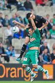 VIENNA,  AUSTRIA - JULY 26 Hamdi Salihi (#9, Rapid) and Adil Rami (#4, Valencia) fight for the ball