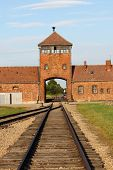 stock photo of auschwitz  - Main entrance to Auschwitz Birkenau Concentration Camp - JPG