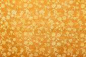 orange handmade art paper with white floral pattern