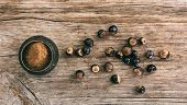 Guarana Nuts And A Metal Mortar On Wooden Background, Top View, Banner poster