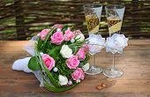 A Wedding Bouquet Is Glasses And Rings
