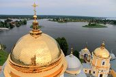Golden cupolas of church and lake