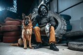 Stalker in gas mask and dog, post-apocalypse poster