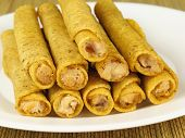 stock photo of flauta  - A plate of hot crispy chicken taquitos - JPG